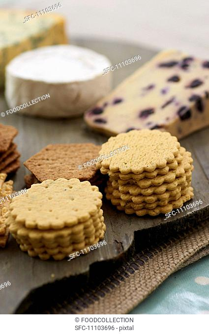 A cheese platter with various crackers