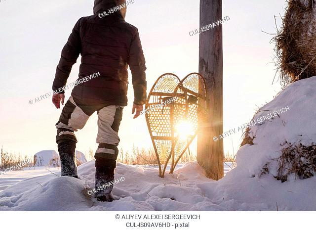 Rear view of man standing in snowy field, Ural, Russia