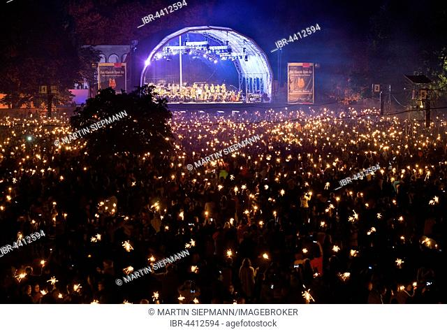 Classical open air Concert at the picnic in the park with Nuremberg Symphonic Orchestra, audience with miracle candles, Luitpoldhain, Nuremberg