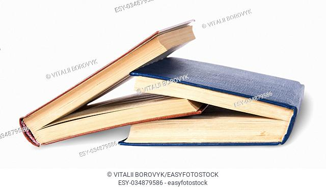 Two old books imbedded in one another rotated isolated on white background