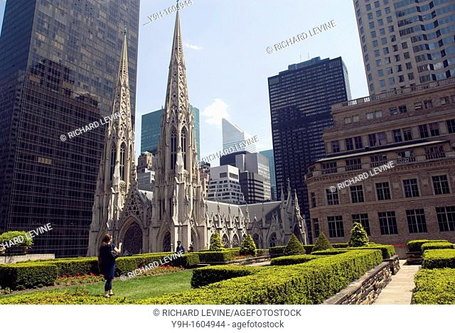 St Patrick's Cathedral is seen from the Channel Garden on the International Building in Rockefeller Center Normally closed to the public the garden is now an...