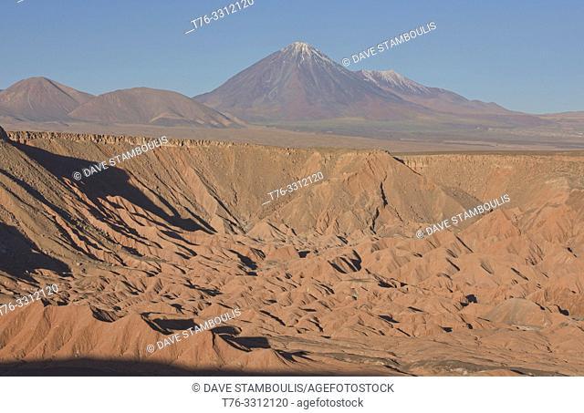 Licancabur volcano rises above the desert landscape in the Valle Marte, San Pedro de Atacama, Chile