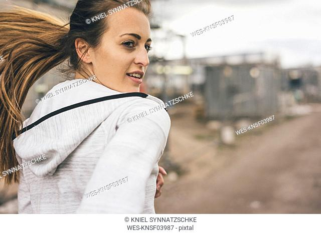 Sportive young woman running outdoors