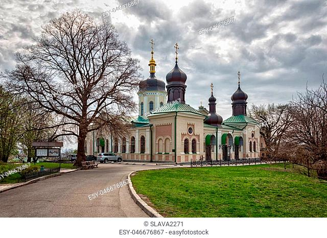 Orthodox Church of Kiev In the botanical garden crosses tend to heaven around trees blossom