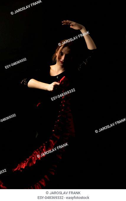 Low Key portrait of young woman dancing flamenco. Vertically