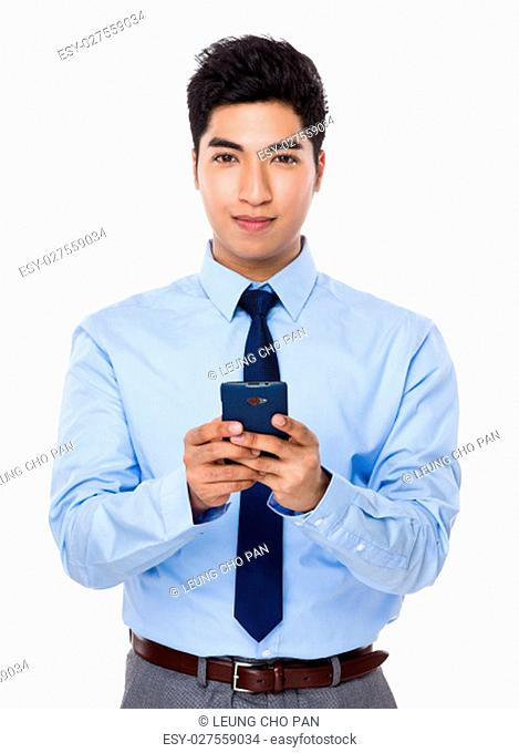 Young Businessman use of the cellphone