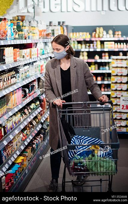 Woman with mask in supermarket