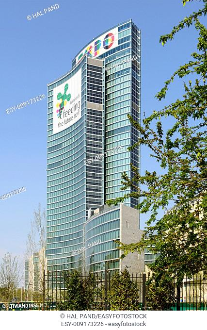 MILAN, ITALY - APRIL 11: view of the building of Regione Lombardia with banners advertising the EXPO 2015 on its facade, shot on april 11 2015 Milan, Italy