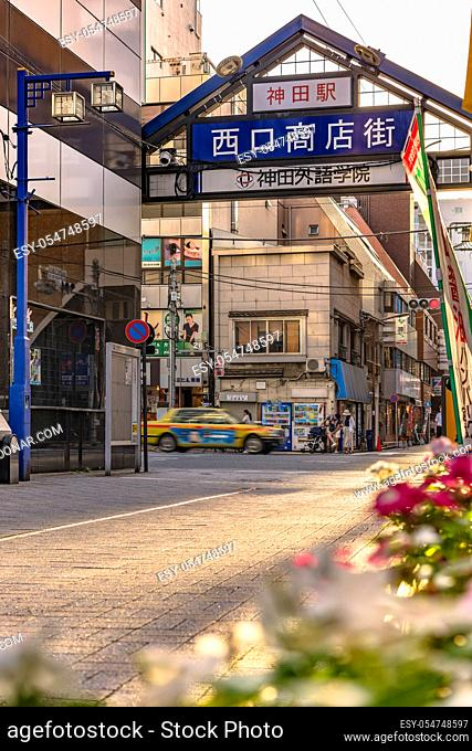 Blue metal entrance gate of the shopping street decorated with flowers from the west exit of Kanda Station on the Yamanote Line