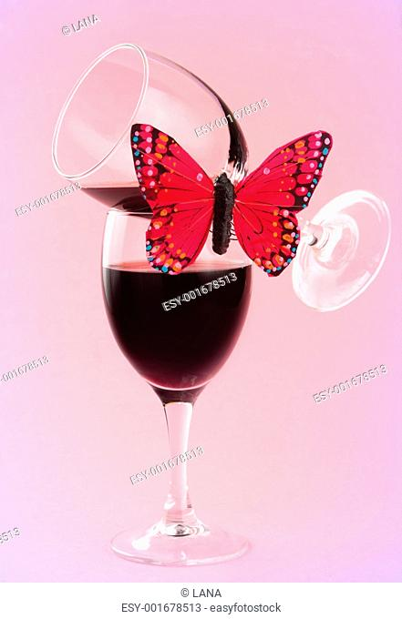 red wine and fake butterflies