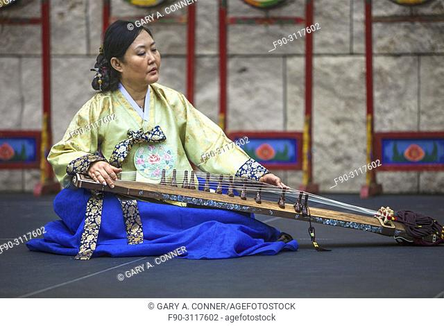 Musician plays gayageum, traditional instrument, at Korean Festival, Getty Center, Los Angeles CA