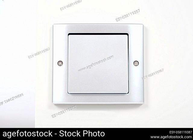 modern light switch on the wall close up