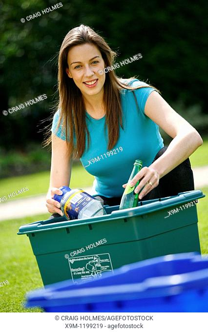 lady sorting recycling, plastic bottles