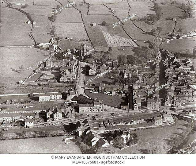 A aerial view of Pateley Bridge in North Yorkshire, viewed from the west. Landmarks include the parish church (just left of centre) and the long three-story...