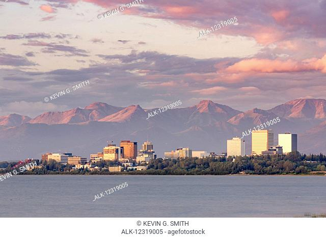 View of downtown Anchorage during an atmospheric sunset as seen from Earthquake Park, Anchorage, Southcentral Alaska, USA, Summer