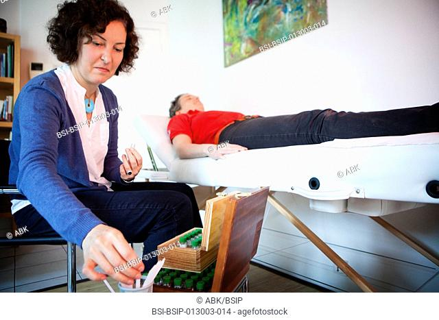 Reportage at an olfactotherapy practice in Paris. Olfactotherapy is a method that uses the smells and vibrations of essential oils to elicit conscious and...