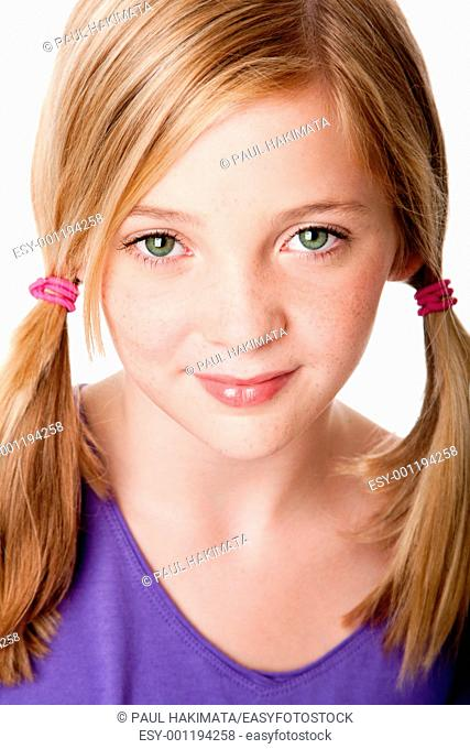 Beautiful cute sincere face of happy teenager girl with pigtails, blond hair, green eyes and freckles, isolated