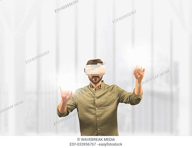 Man in VR headset touching flares against white background