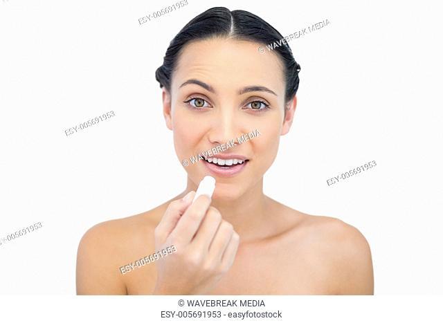 Smiling natural model using lip balm