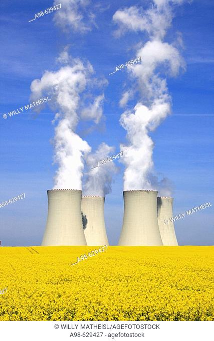 Nuclear power station and rape field. Temelin. District of Budweis. South Bohemia, Czech Republic