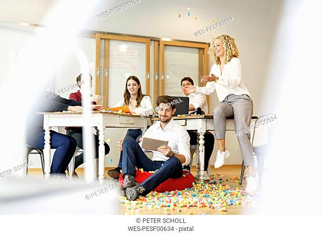 Creative professionals meeting in office surrounded by colorful polystyrene parts