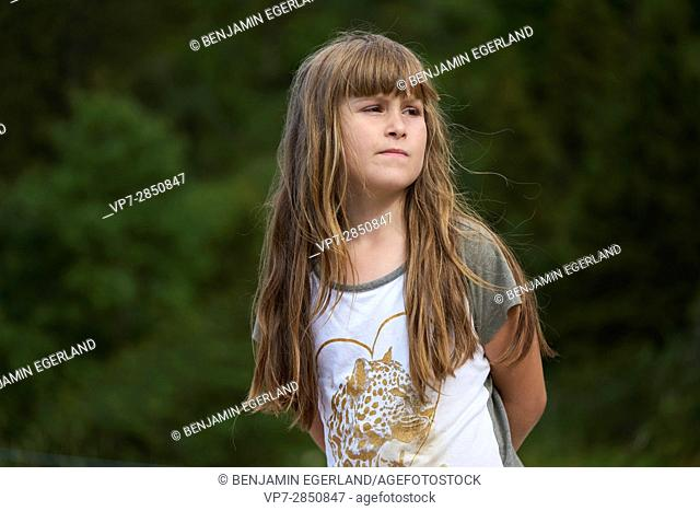 thoughtful young female child in nature, Bavaria, Germany