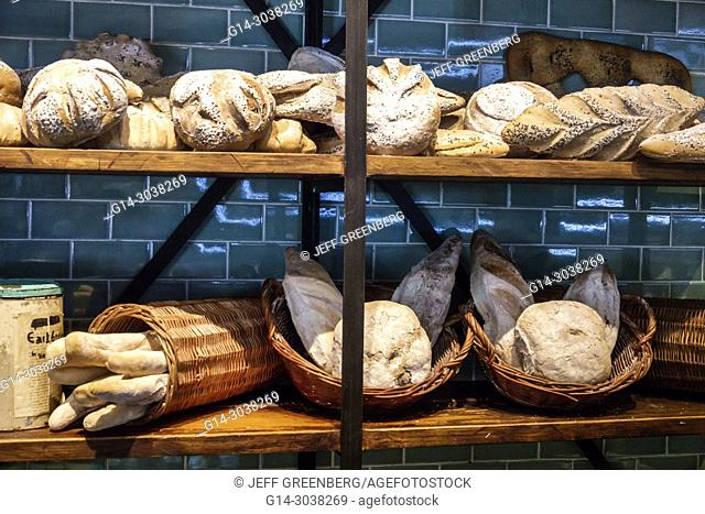 Argentina, Buenos Aires, The Dandy Libertador Bar & Grill, restaurant, interior, dining, display, artisanal bread, Hispanic