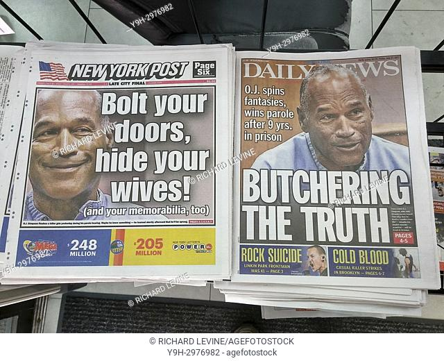 The headlines of New York tabloid newspapers on Friday, July 21, 2017 report O. J. Simpson being granted parole after 9 years in prison. (© Richard B