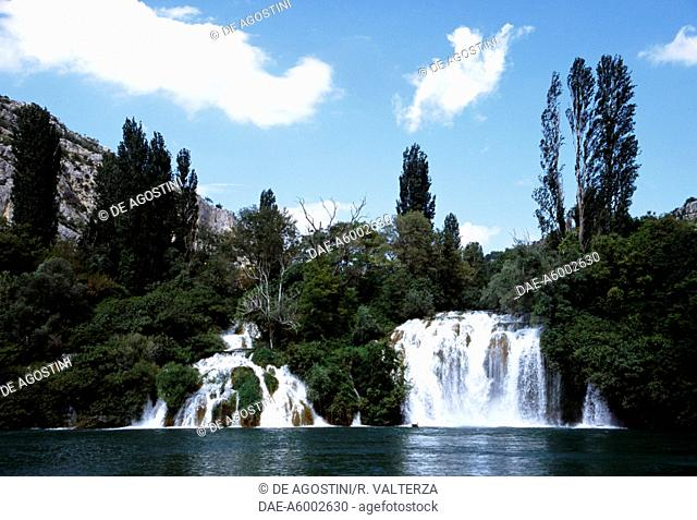 The Krka River at the height of the Roski Slap Waterfalls, consisting of the main falls (22.5 metres high and 450 metres wide) and the lower falls known as The...
