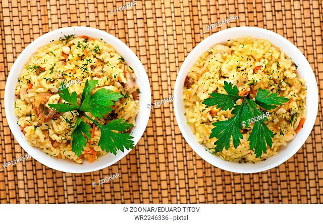 pilaf (meat, carrots, rice) decorated parsley