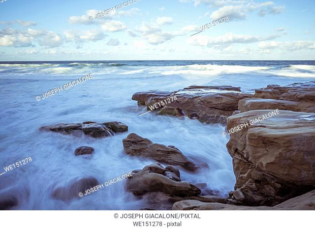Ocean surf and rocky coast with clouds in the morning, Windansea Beach, La Jolla, California, USA