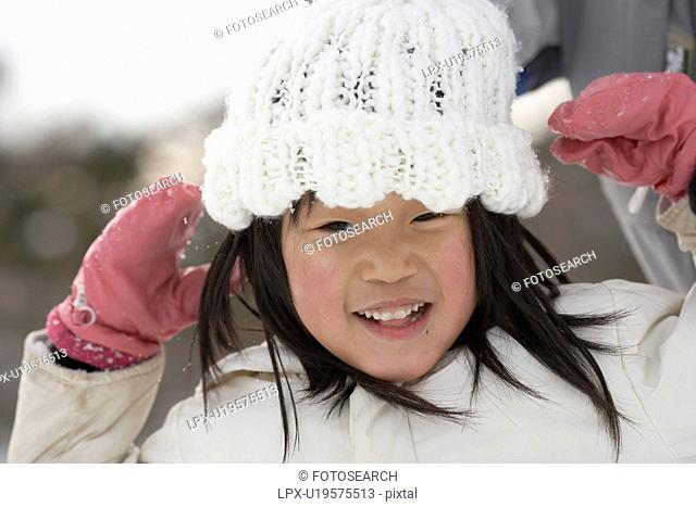 Girl with knit hat