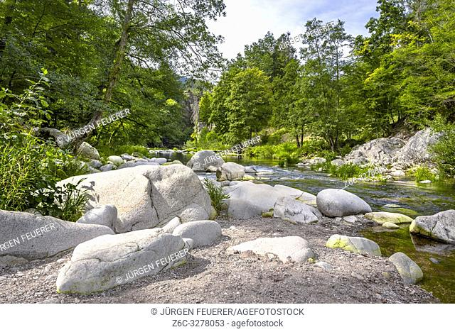 riverside with big boulders of the river Murg, Northern Black Forest, Germany, wild nature in the Murg valley near Forbach
