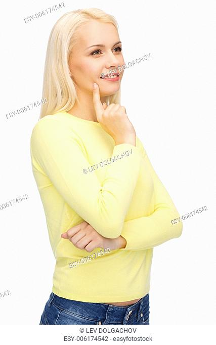 happiness and people concept - happy smiling young woman dreaming