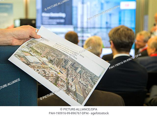 16 September 2019, Hessen, Frankfurt/Main: A man is holding a press release on the Federal Transport Infrastructure Plan (BVWP) 2030 in his hands