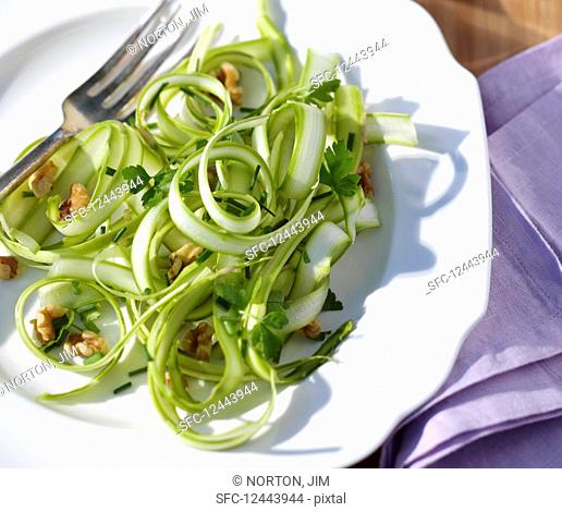 Green asparagus strips with walnuts and herbs