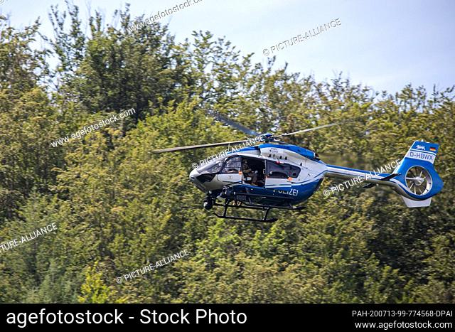 13 July 2020, Baden-Wuerttemberg, Oppenau: A police helicopter flies over the forest near the community of Oppenau. Because of the police operation in Oppenau...