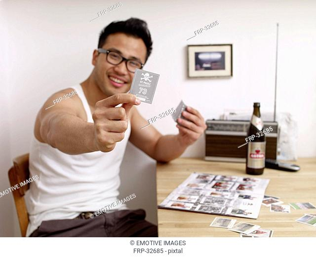 Happy man holding soccer collector card