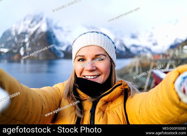 Selfie of smiling tourist at Hamnoy, Lofoten, Norway