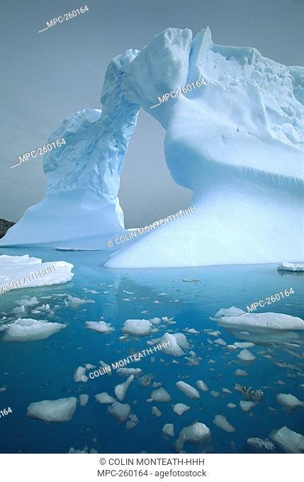 Iceberg with arch, Petermann Island, Antarctic Peninsula, Antarctica