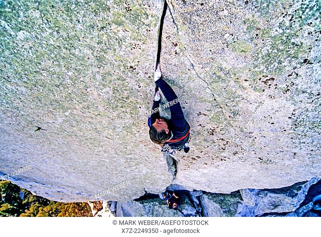 Rock climbing a route called Pole Cat which is rated 5, 10 and located on the Sorcerers Stone at Castle Rocks State Park near the town of Almo in southern Idaho
