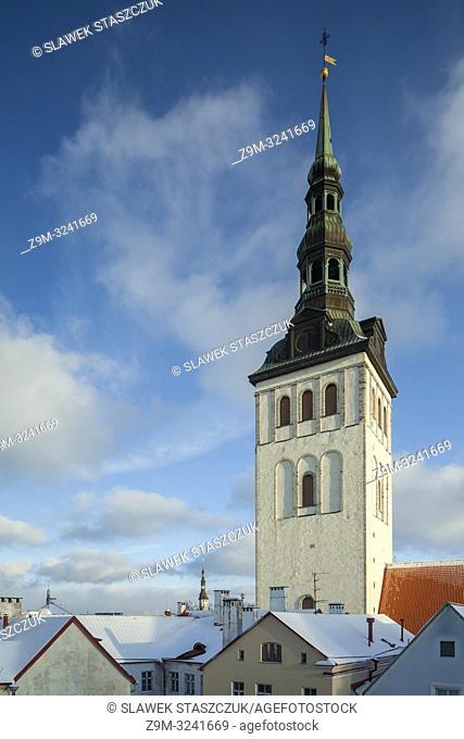 Winter in Tallinn old town, Estonia. St Nicolas church tower dominates the skyline