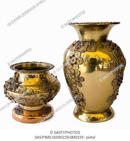 Close-up of antique decorative metal pots