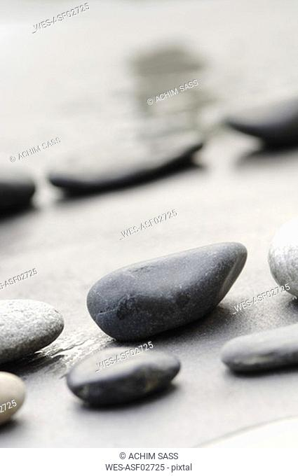 Pebbles in sand, in a row, tilt view