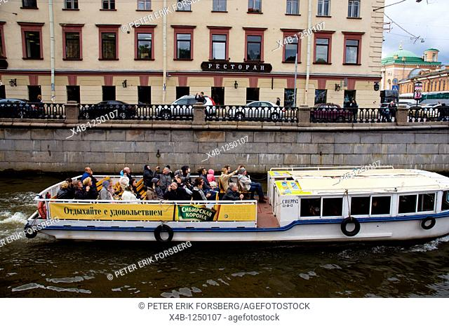 Sightseeing tour boat on Griboedova canal central St Petersburg Russia Europe