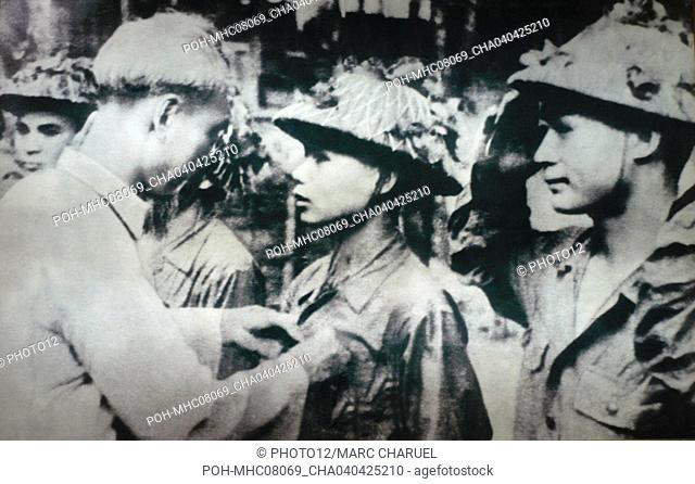 Close up of general Hi Chi Minh honouring a soldier 1954