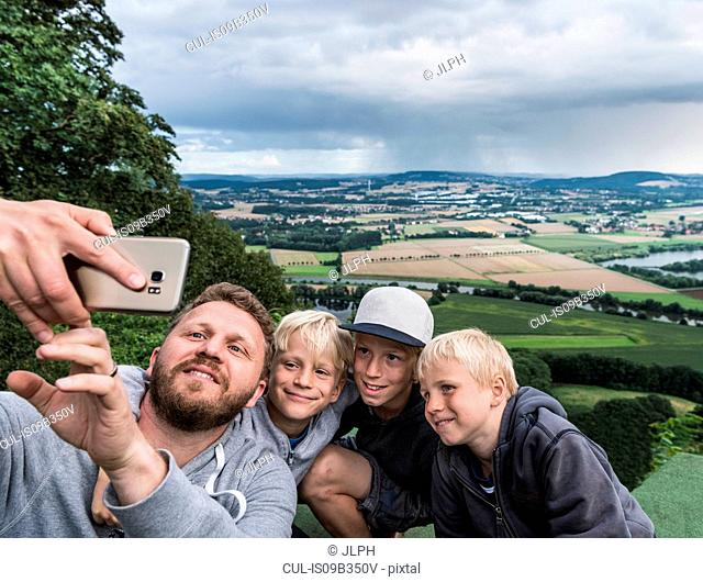 Father and sons taking selfie