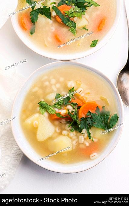 Barley soup, pearl barley in white bowl