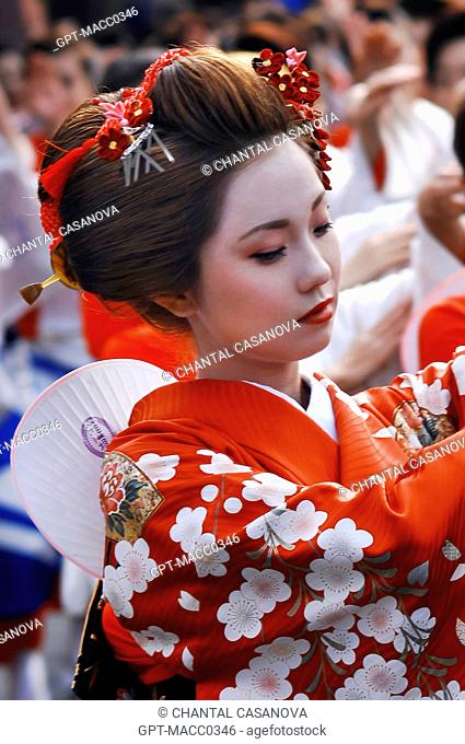 JAPANESE WOMAN DRESSED AS A MAIKO APPRENTICE GEISHA AND WEARING THE TRADITIONAL MAKEUP DORAN DURING THE FEUDAL FESTIVAL OF THE LORDS, THE DAIMYO GYORETSU