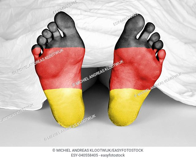 Dead body under a white sheet, flag of Germany